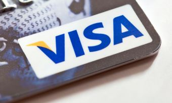 It does not issue cards, credit, interest rates or fees, yet the name Visa is on every second credit card you see. What is Visa and how does it make money?