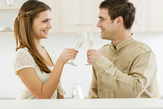 couple toast to their new home